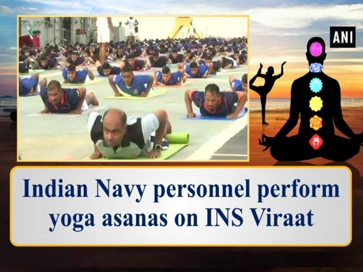Indian Navy personnel perform yoga asanas on INS Viraat