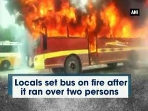 Locals set bus on fire after it ran over two persons