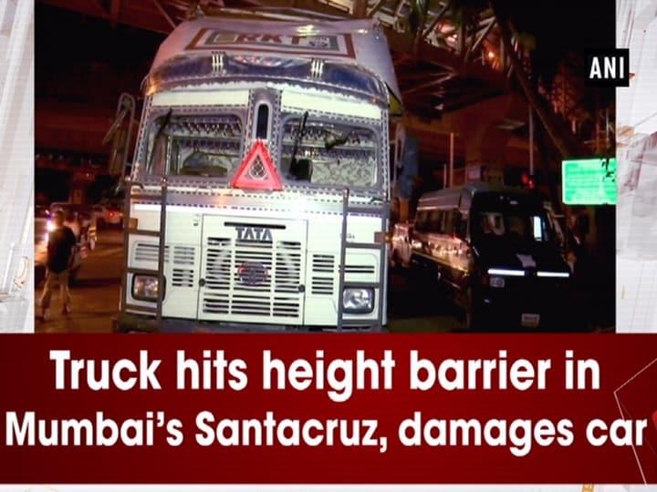 Truck hits height barrier in Mumbai's Santacruz, damages car