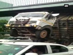 Watch: Dumper truck gets stuck under foot-over bridge