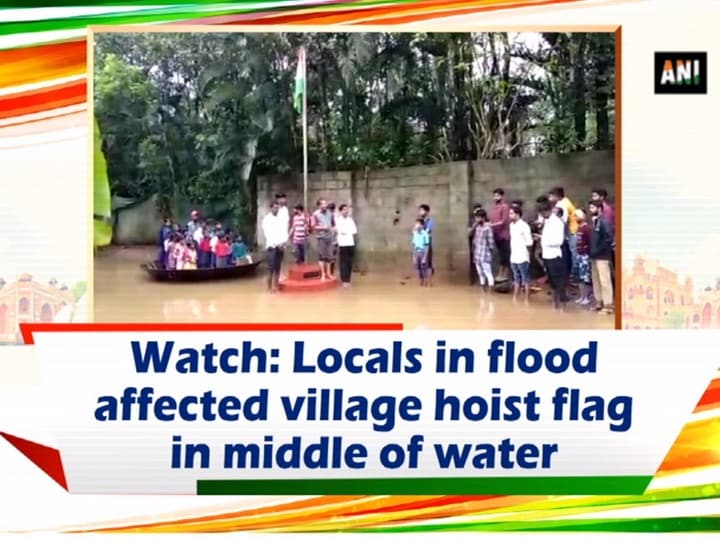 Watch: Locals in flood affected village hoist flag in middle of water