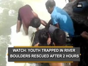 Watch: Youth trapped in river boulders rescued after 2 hours