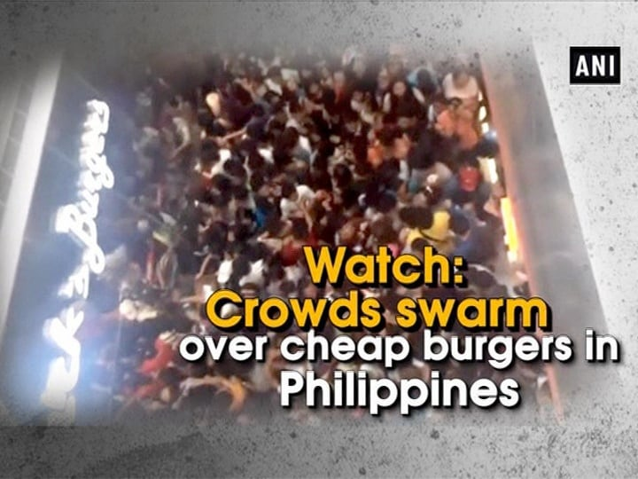 Watch: Crowds swarm over cheap burgers in Philippines