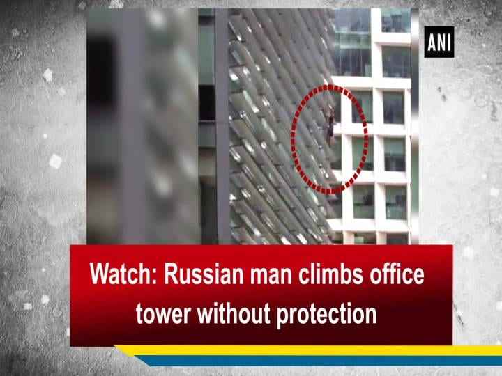Watch: Russian man climbs office tower without protection