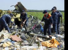 Ukrainian emergency workers dismantle the wreckage at the crash site of Malaysia Airlines Flight 17 near the village of Hrabove, eastern Ukraine, on July 20, 2014.
