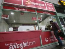 A passenger stands outside the SpiceJet Airlines ticket counter at the domestic airport on the outskirts of Agartala