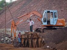 Employees are seen at the Bedara Bhommanahalli (BBH) iron ore mines at Chitradurga in Karnataka
