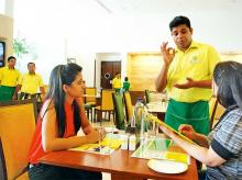 Staff catering to customers at a Lemon Tree outlet. About 10% of Lemon Tree's total workforce is accounted for by specially abled people