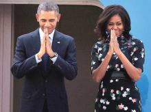 US President Barack Obama and first lady Michelle Obama fold their hands in a namaste gesture before their departure from Air Force Station, Palam, in New Delhi on Tuesday