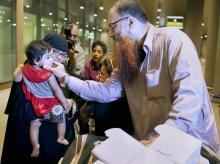 A relative receives one of the Indian nationals evacuated from Yemen, upon their arrival at the International Airport in Mumbai early Monday morning, April 6 2015 Picture by PTI