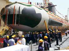 Workers and engineers from Mazagon Dock cheer during the floating of the first Project 75 (Scorpene) submarine on pontoon, in Mumbai, on Monday
