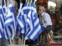 A vendor waits for customers outside his shop in central Athens, Greece
