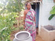 File photo of a woman outside a public toilet