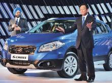 Kenichi Ayukawa (right), MD & CEO, and R S Kalsi, executive director (marketing & sales),  at the launch of S-Cross in New Delhi, on Wednesday