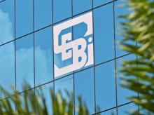 The logo of the Securities and Exchange Board of India (SEBI), India's market regulator, is seen on the facade of its head office building in Mumbai