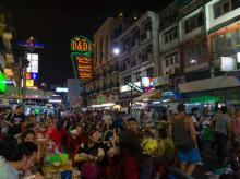 A street in Bangkok lined with eateries