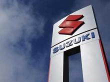 A view shows a Suzuki car dealership sign in National City, California