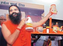 Yoga guru Ramdev with Patanjali Ayurved's products