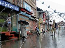 A security personnel stands guard during a bandh in Kashmir