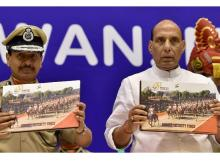 Home Minister Rajnath Singh along with BSF DG D K Pathak release a coffee table book during the BSF Golden Jubilli Year celebrations in New Delhi