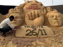 Sand sculptor Sudarshan Patnaik making memorial for paying tribute to Mumbai terror attack 2008 victims