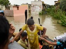 People being rescued from inundated Kotturpuram locality after heavy rains in Chennai