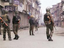 CRPF jawans patrol a street during restrictions imposed by the authorities at a strike called by the Hurriyat Conference at Lal Chowk in Srinagar on Saturday