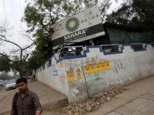 A man walks past Sahara India Complex building in Noida on the outskirts of New Delhi