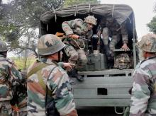 Security personnel during their operations at Bhullaechak Colony village near Tibri Cantt in Gurdaspur village on Thursday.  Locals informed police to have seen two suspected militants in army outfit in the area. PTI Photo