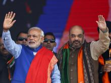 Prime Minister Narendra Modi and Amit Shah, president of Bharatiya Janata Party (BJP) wave to their supporters during a campaign rally. Photo: Reuters