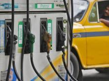 A driver waits in a taxi for his turn to fill up his tank with diesel at a fuel station in Kolkata. Photo: Reuters