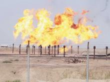 File photo of excess gas being burnt off a pipeline at Rumaila oilfield in Basra, Iraq