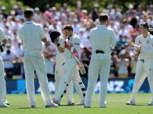 New Zealand's captain Brendon McCullum receives a honour guard from the Australian players as he heads to the crease in his final test on the first day of the second Test match at Hagley Park Oval in Christchurch, New Zealand.