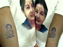 AIADMK party workers get Jayalalithaa's picture tattooed on their arms to mark her 68th birthday. Photo: ANI