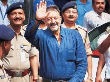 Actor Sanjay Dutt greets fans outside his residence after his release from Pune's Yerawada Jail in Mumbai on Thursday
