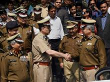 New Police Commissioner of Delhi, Alok Kumar Verma  seeing off his predecessor B S Bassi after taking charge from him at Police Head Quarters in New Delhi