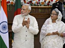 Prime Minister Narendra Modi and his Bangladeshi counterpart Sheikh Hasina clap during signing ceremony of agreements between India and Bangladesh in Dhaka. Photo: Reuters