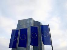 EU flags fly in front of the European Central Bank headquarters in Frankfurt, Germany.