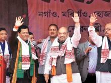 Bharatiya Janata Party National President Amit Shah (second from right) with Union Minister for Sports Sarbananda Sonowal (second from left) and others during a public rally in Nagaon on Wednesday