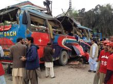 The blast was in a bus carrying employees of Civil Secretariat, government officials coming from Mardan. Photo: The Express Tribune