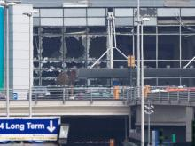 The blown out windows of Zaventem airport are seen after a deadly attack in Brussels, Belgium