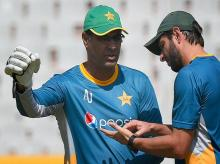 Pakistan captain Shahid Afridi with coach Waqar Younis during a training session on the eve of World Cup T20 match against Australia in Mohali