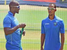 West Indies former captain Darren Sammy (L) with Lendl Simmons. File photo: PTI