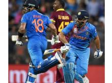 India's Virat Kohli and MS Dhoni in action during  ICC WT20 Semi Final match against West Indies at Wankhede Stadium in Mumbai