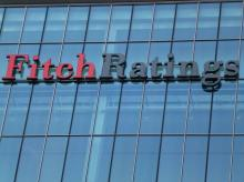 High govt support to banks to deal with stressed asset 'negative' : Fitch