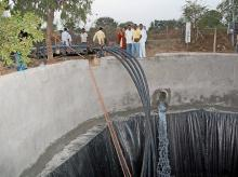 Water is stored in a well after Central Railway water train arrived at drought affected Latur district, Maharashtra