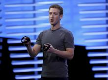 Facebook CEO Mark Zuckerberg holds a pair of the touch controllers for the Oculus Rift virtual reality headsets on stage during the Facebook F8 conference in San Francisco, California. Photo: Reuters