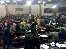 Supporters of Shiite cleric Muqtada al-Sadr storm parliament in Baghdad's Green Zone