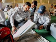 Poll officials check EVMs ahead of Bilari bypolls in Moradabad. Photo: PTI