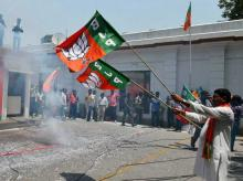 BJP workers celebrate party victory in Assam 2016 polls